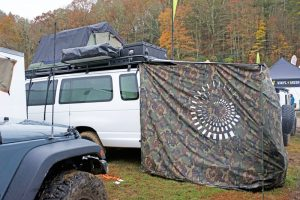 If we'd have had a nifty awning like this to create an outdoor room next to our van....
