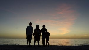 Family on the beach at sunset during the government shutdown